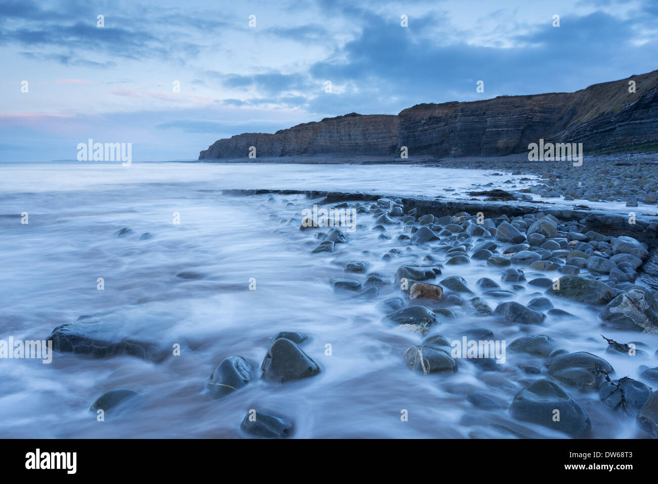 Incoming tide at Kilve Beach in Somerset, England. Winter (January) 2014 - Stock Image