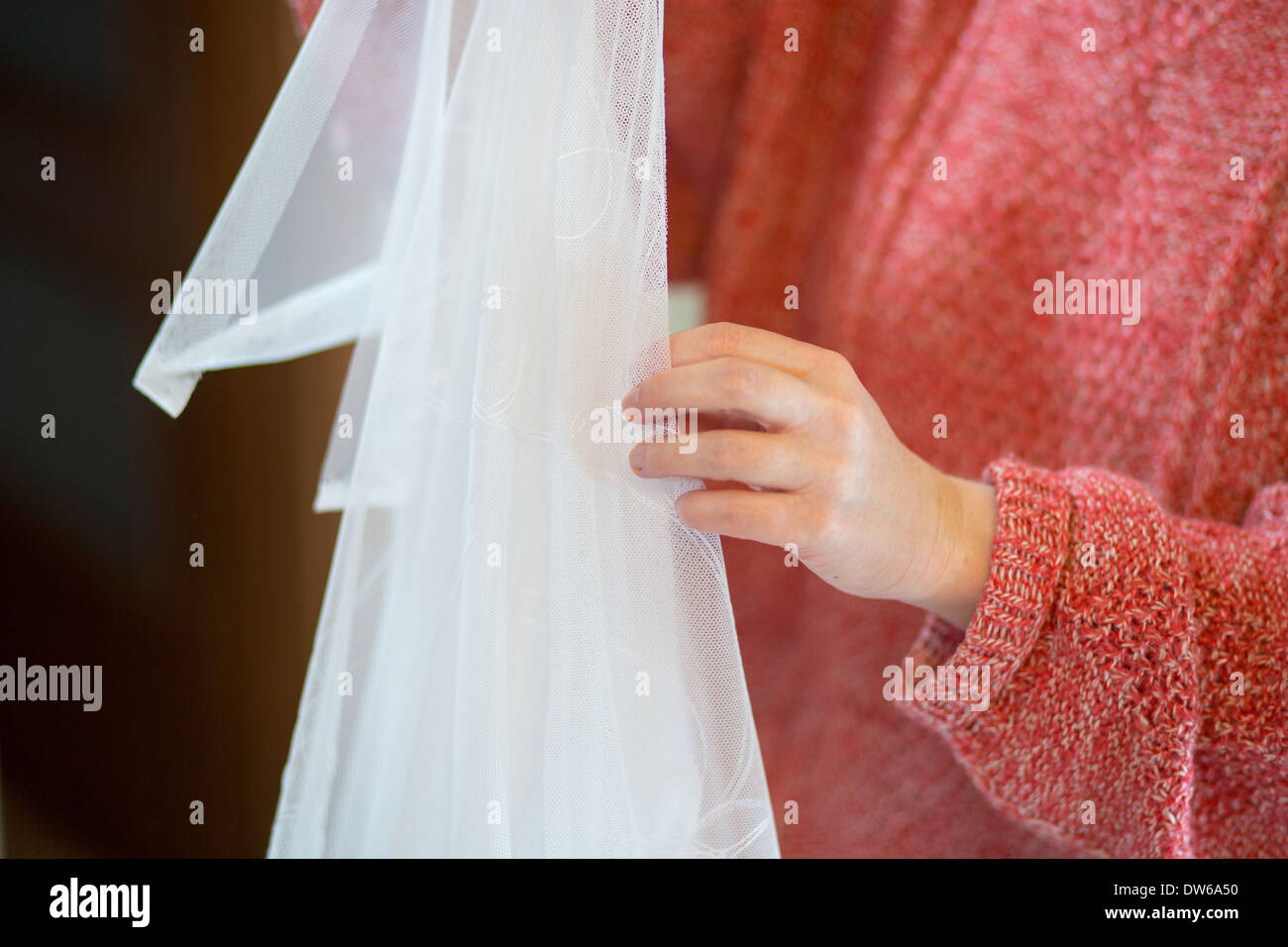 Working from home, beautiful drapes and the remarkable curtains tailor at work. - Stock Image
