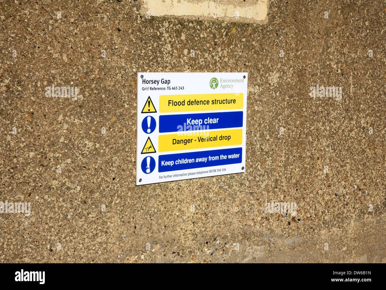 A hazards sign at Horsey Gap, Norfolk, England, United Kingdom. - Stock Image