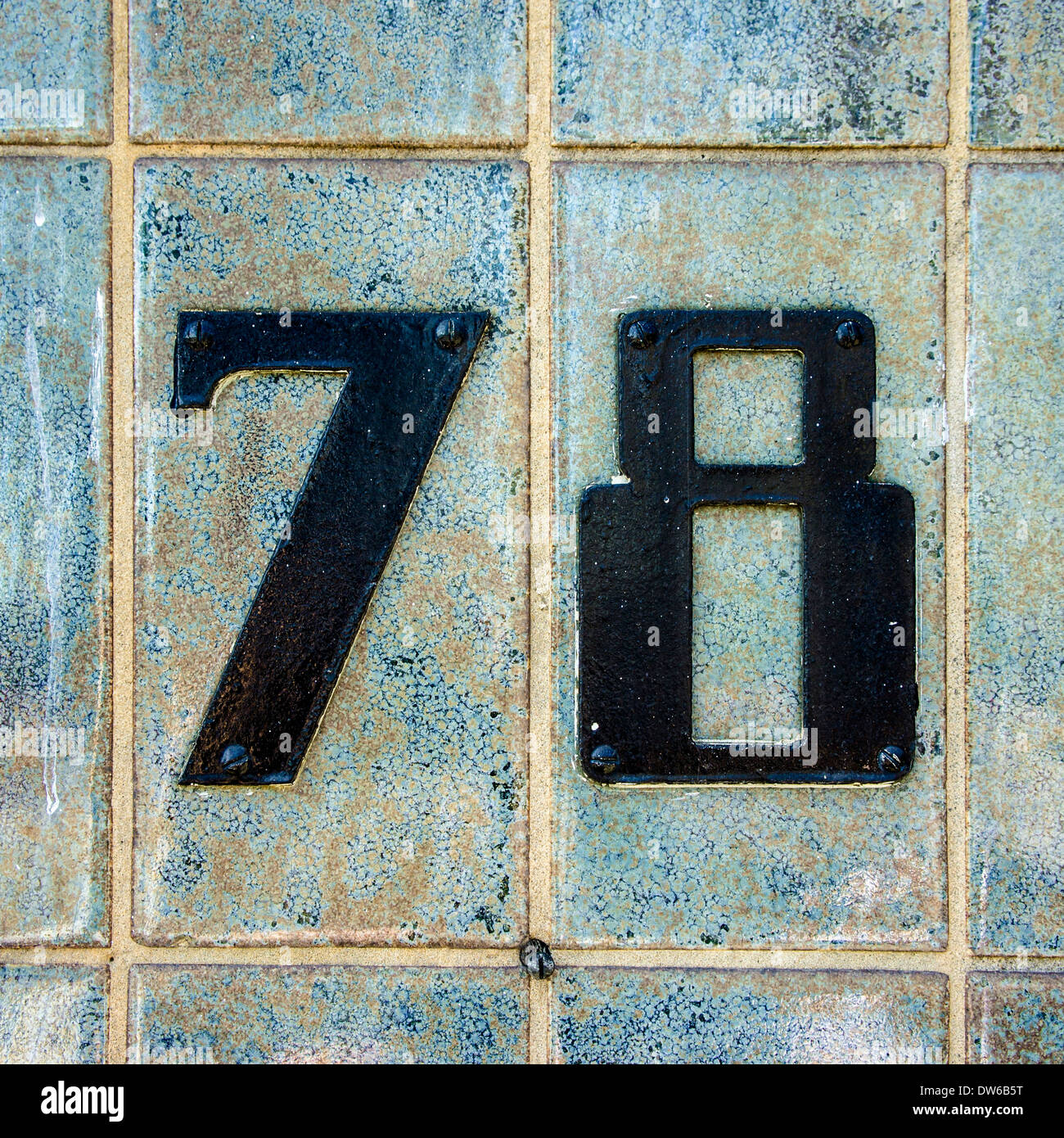 black house number seventy-eight on a wall of ceramic tiles Stock ...