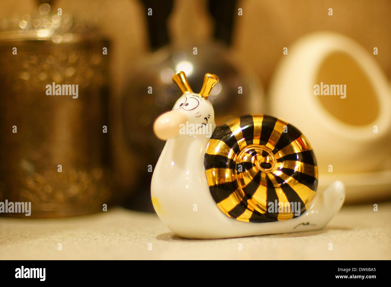 Figurine of snail salt cellar - Stock Image