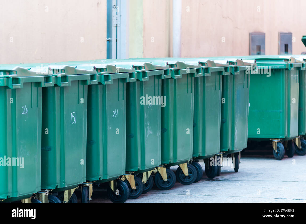 A row of garbage bins in an alleyway in Singapore. - Stock Image