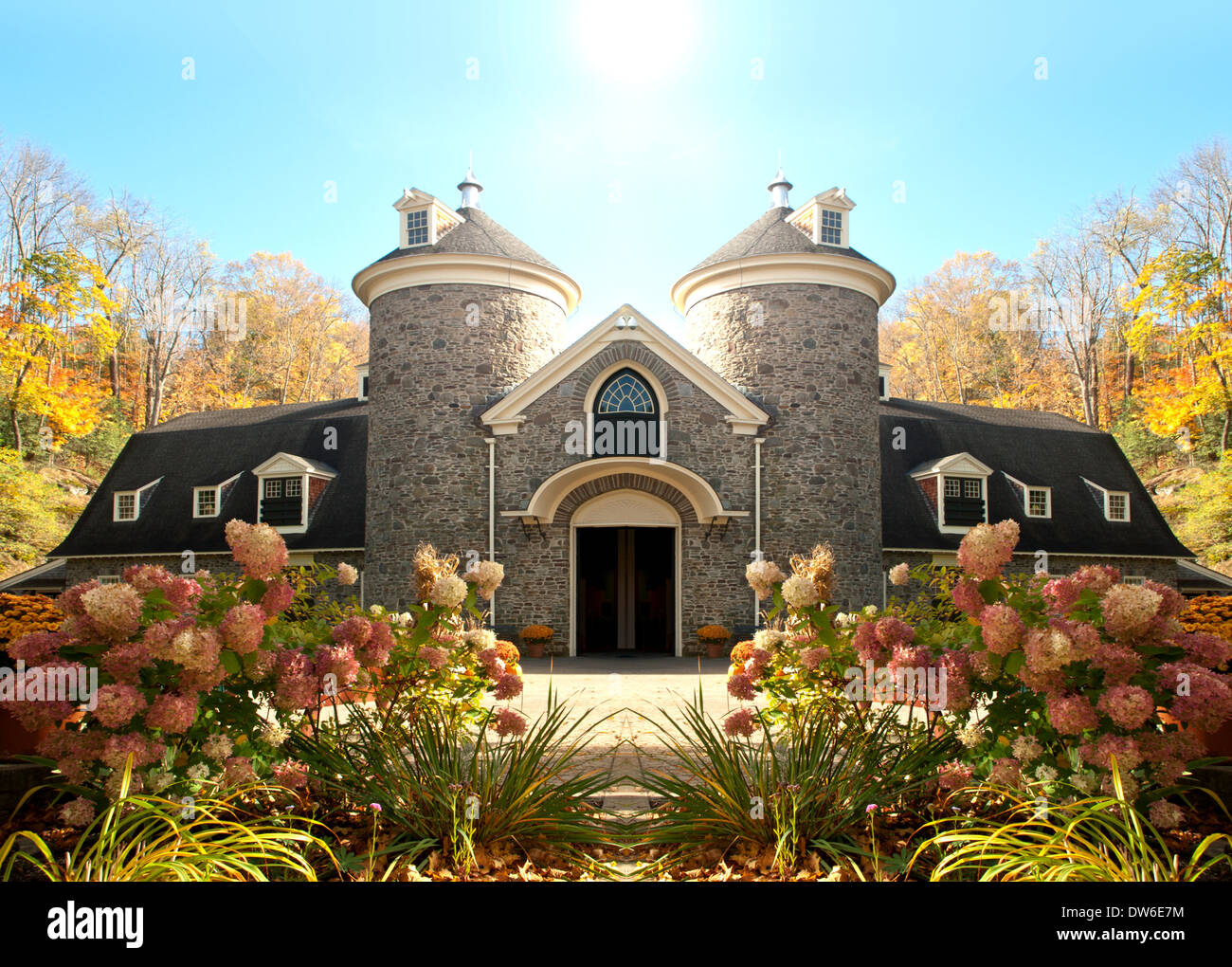 beautiful house with turrets in daylight - Stock Image