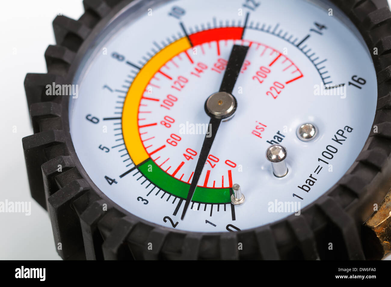 A compressor pressure gauge on a white background - Stock Image