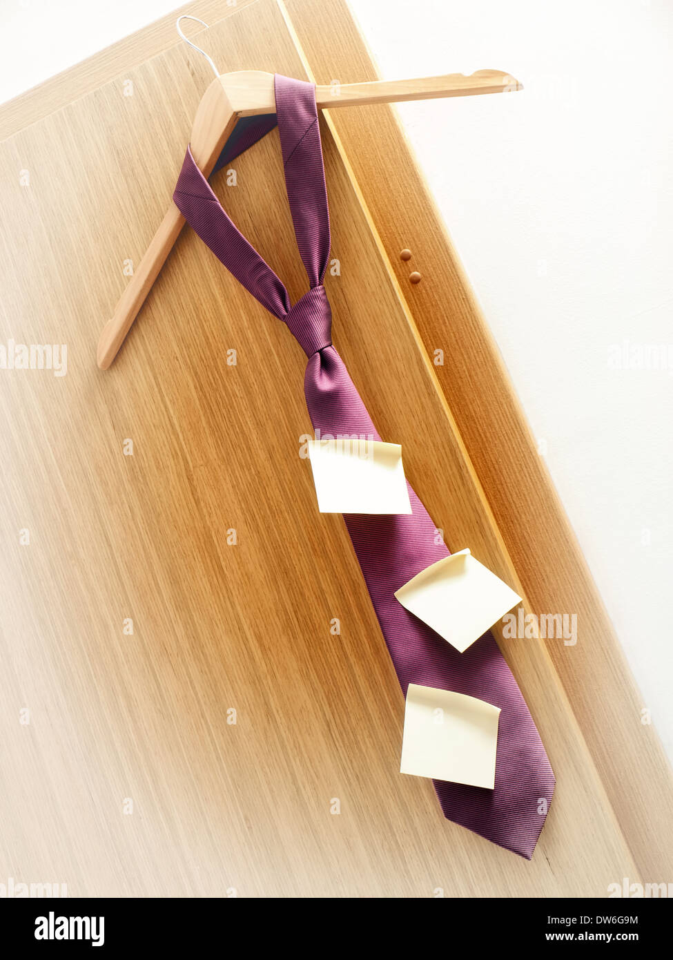 Few sticky notes on a tie as a symbol of planning in business. - Stock Image