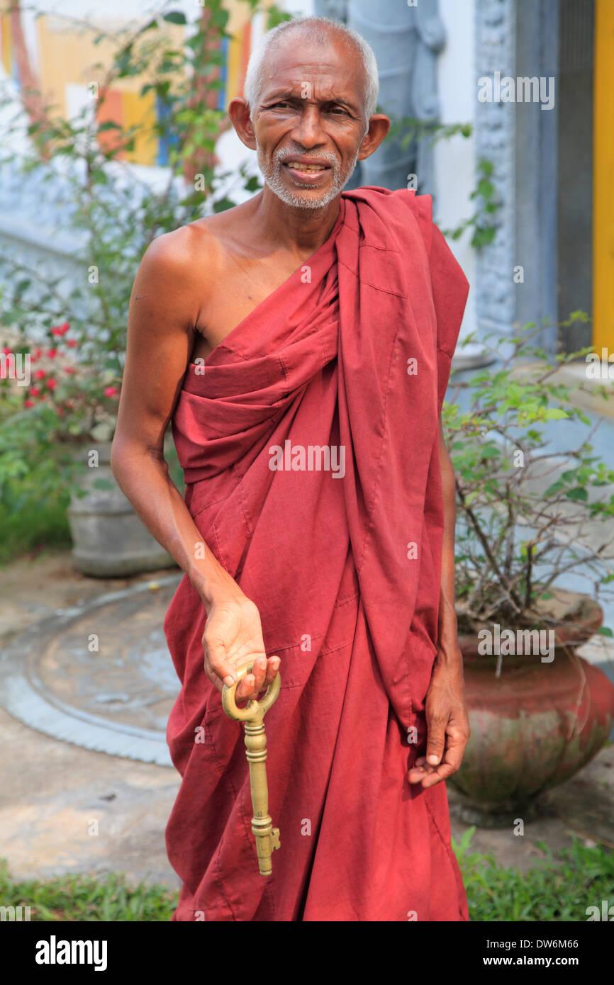 Sri Lanka, Hikkaduwa, old buddhist monk with a key, - Stock Image
