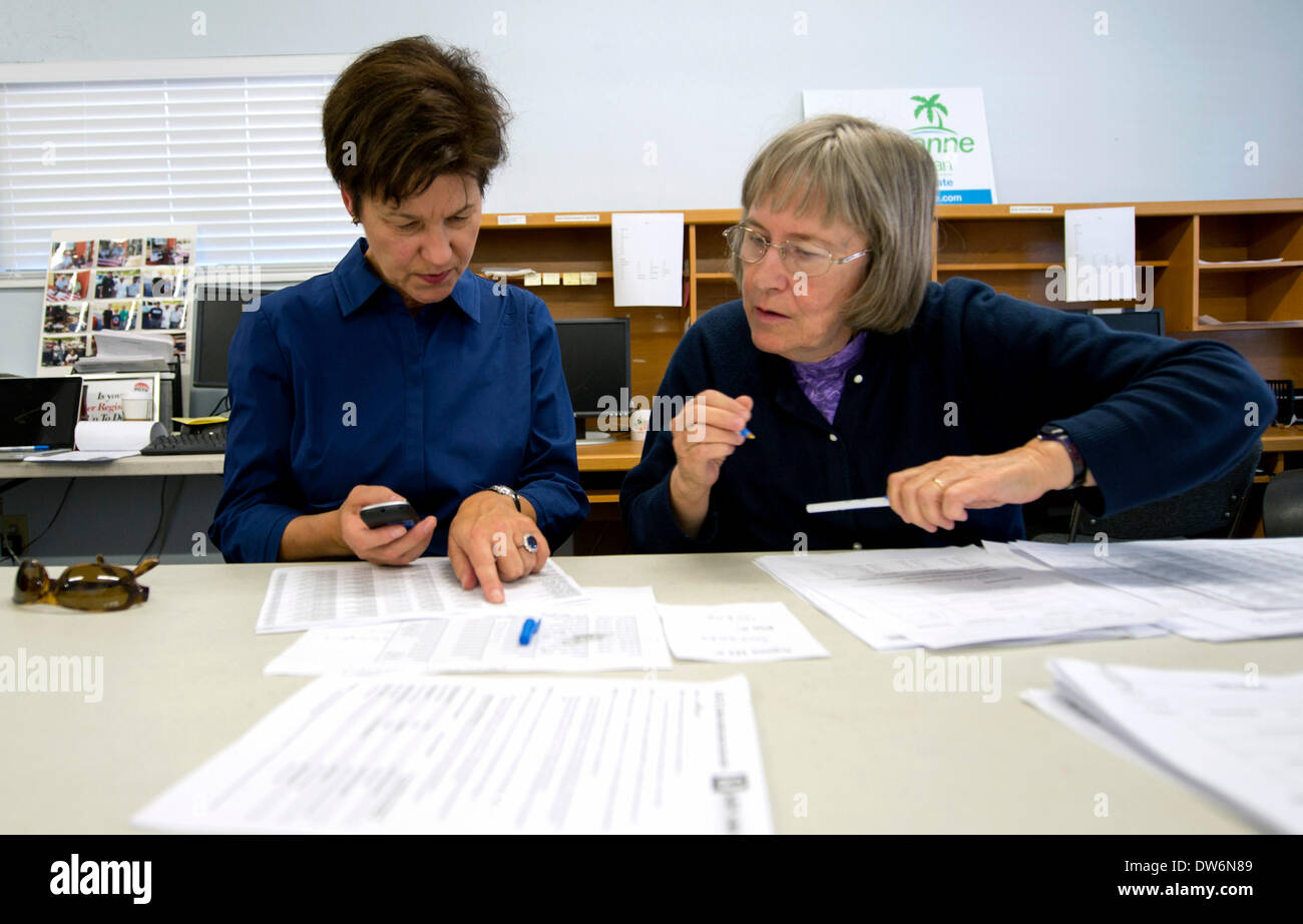 March. 01, 2014 - St. Petersburg, Florida, U.S. - ALEX SINK, left, Democratic candidate in Florida's 13th Congressional District race, makes phone calls to voters with help from get-out-the-vote phone bank volunteer DEBI DUTY during a visit to Pinellas County Democratic headquarters. Sink, Republican David Jolly and Libertarian Lucas Overby are competing for the seat left open when long-time Congressman Bill Young died in October of 2013. The special election will be held on Tuesday, March 11.(Credit Image: © Brian Cahn/ZUMAPRESS.com) - Stock Image