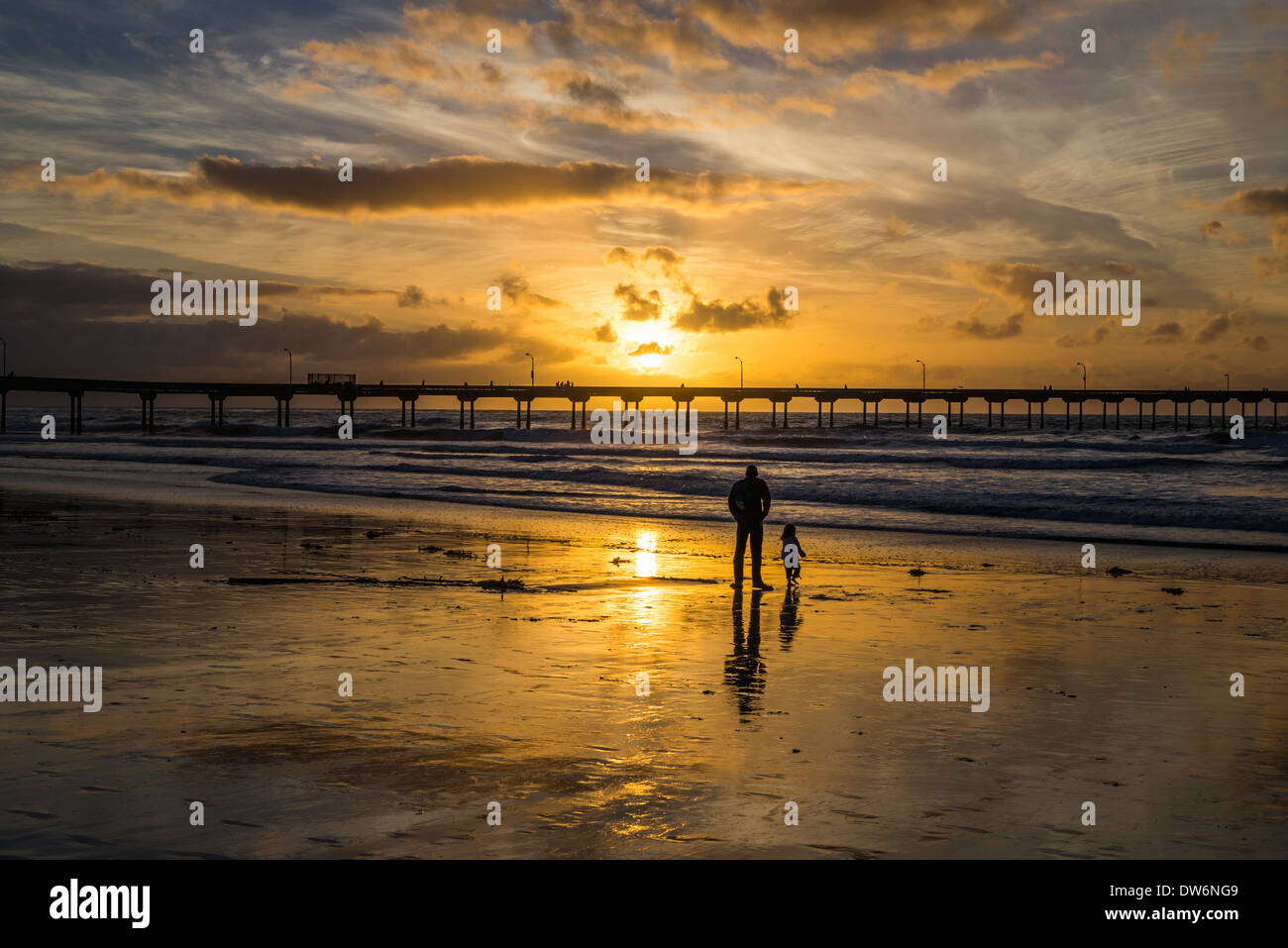 Ocean Beach and the Ocean Beach Pier with vibrant sunset. San Diego, California, United States. - Stock Image