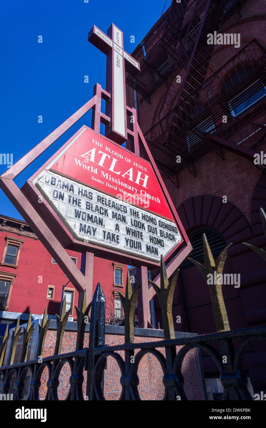 The ATLAH World Missionary Church on Lenox Avenue in Harlem in New York posts a homophobic message - Stock Image