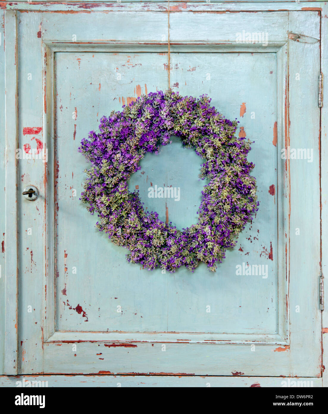 Lavender Flower Wreath Hanging On An Old Wooden Vintage Kitchen Door Frame  With Copy Space