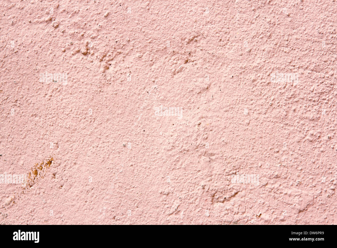 Plastered cream and pink color old cement wall background for copy space Stock Photo