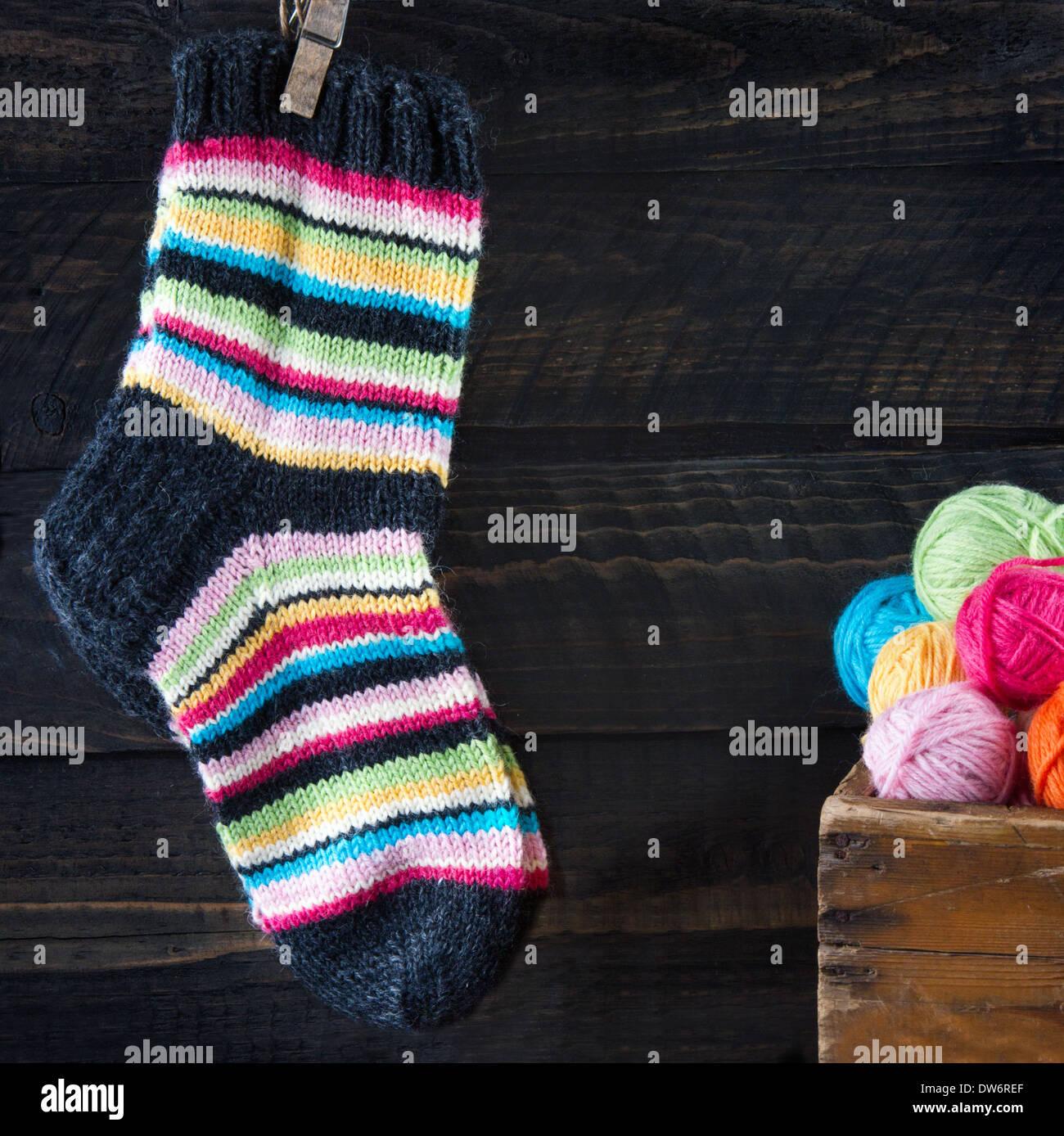 Striped woolen socks hanging on clothesline - Stock Image