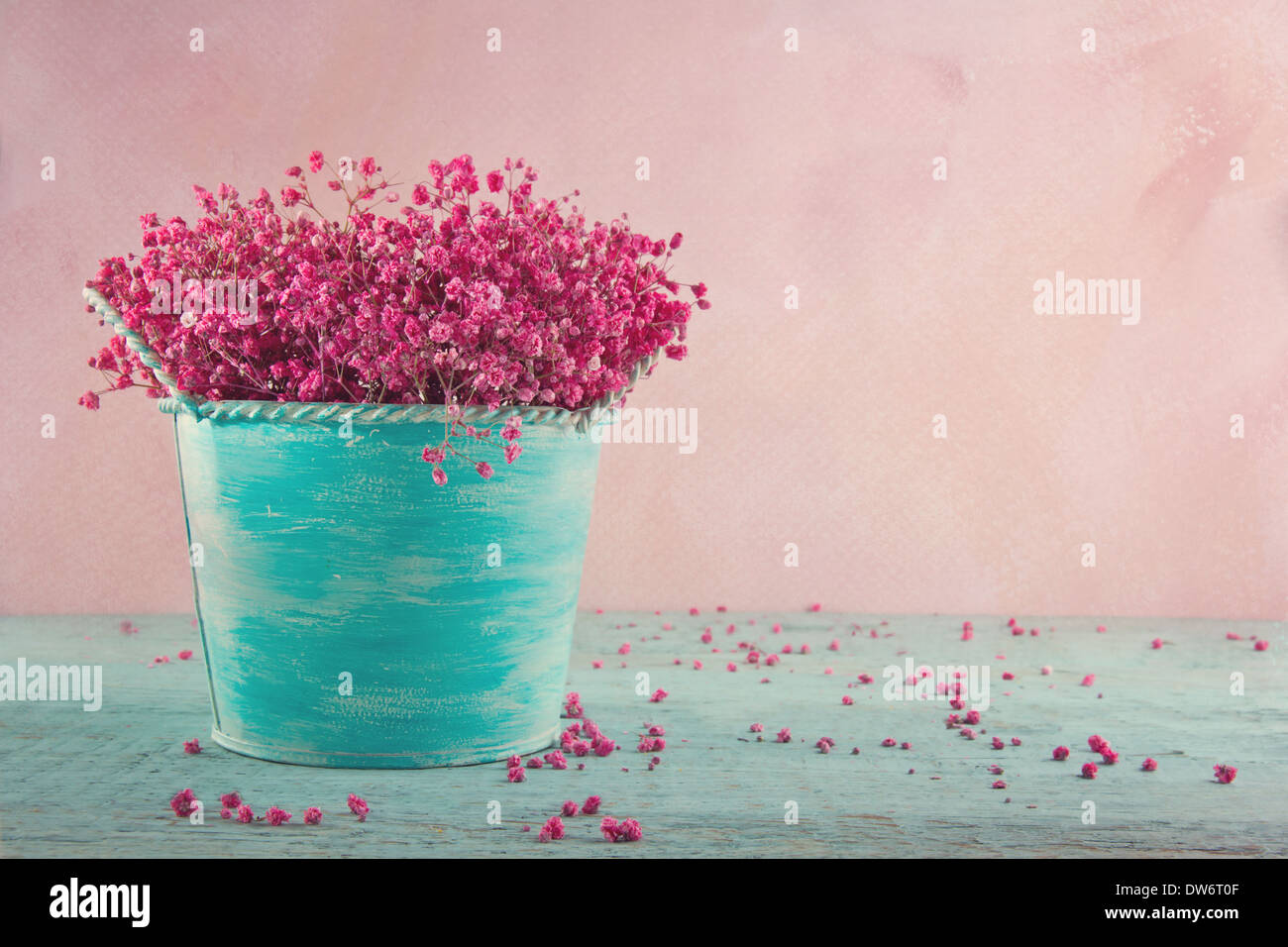 Pink dried babys breath flowers in a blue vase on wooden vintage pink dried babys breath flowers in a blue vase on wooden vintage background mightylinksfo