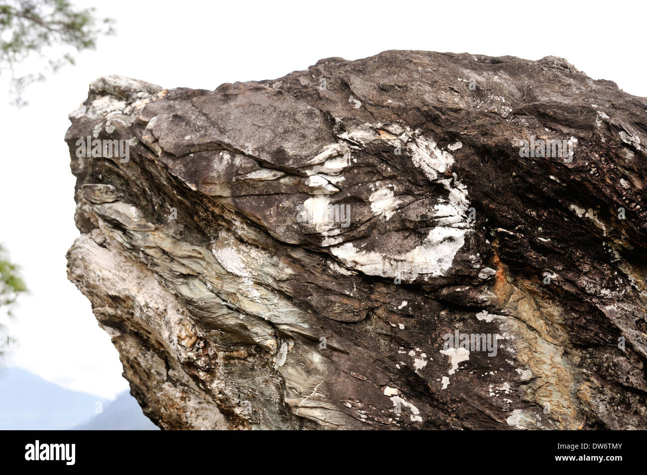 Rock formation which is believed to resemble a frog's head with an eye drown on the surface, Eastern Bhutan - Stock Image