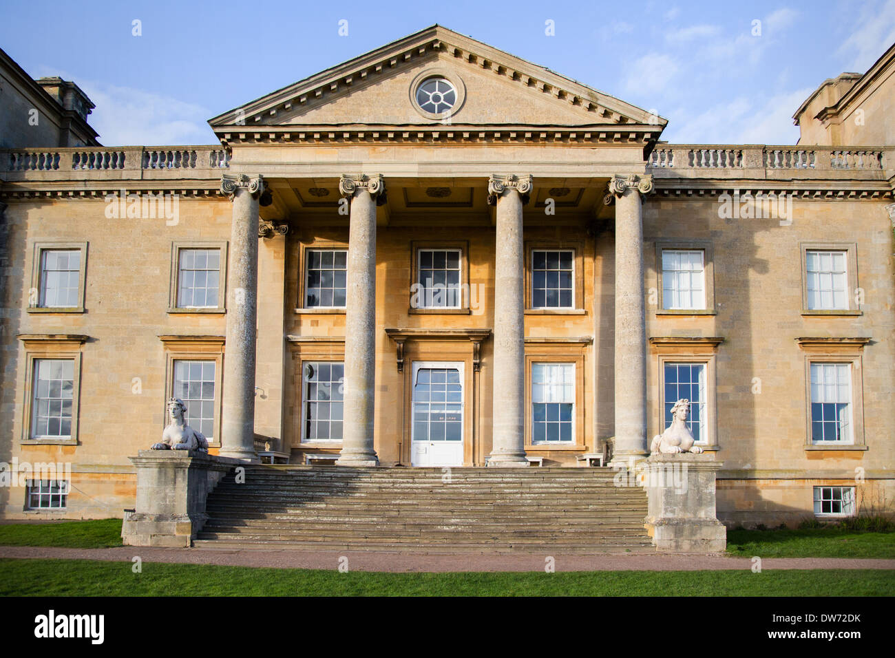 South portico of Croome Park in Worcestershire with broad steps flanked by sphinxes - Stock Image