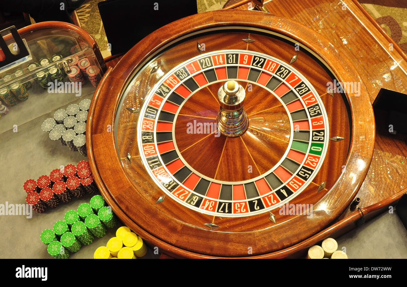 image with a casino roulette wheel with the ball bird eye view - Stock Image