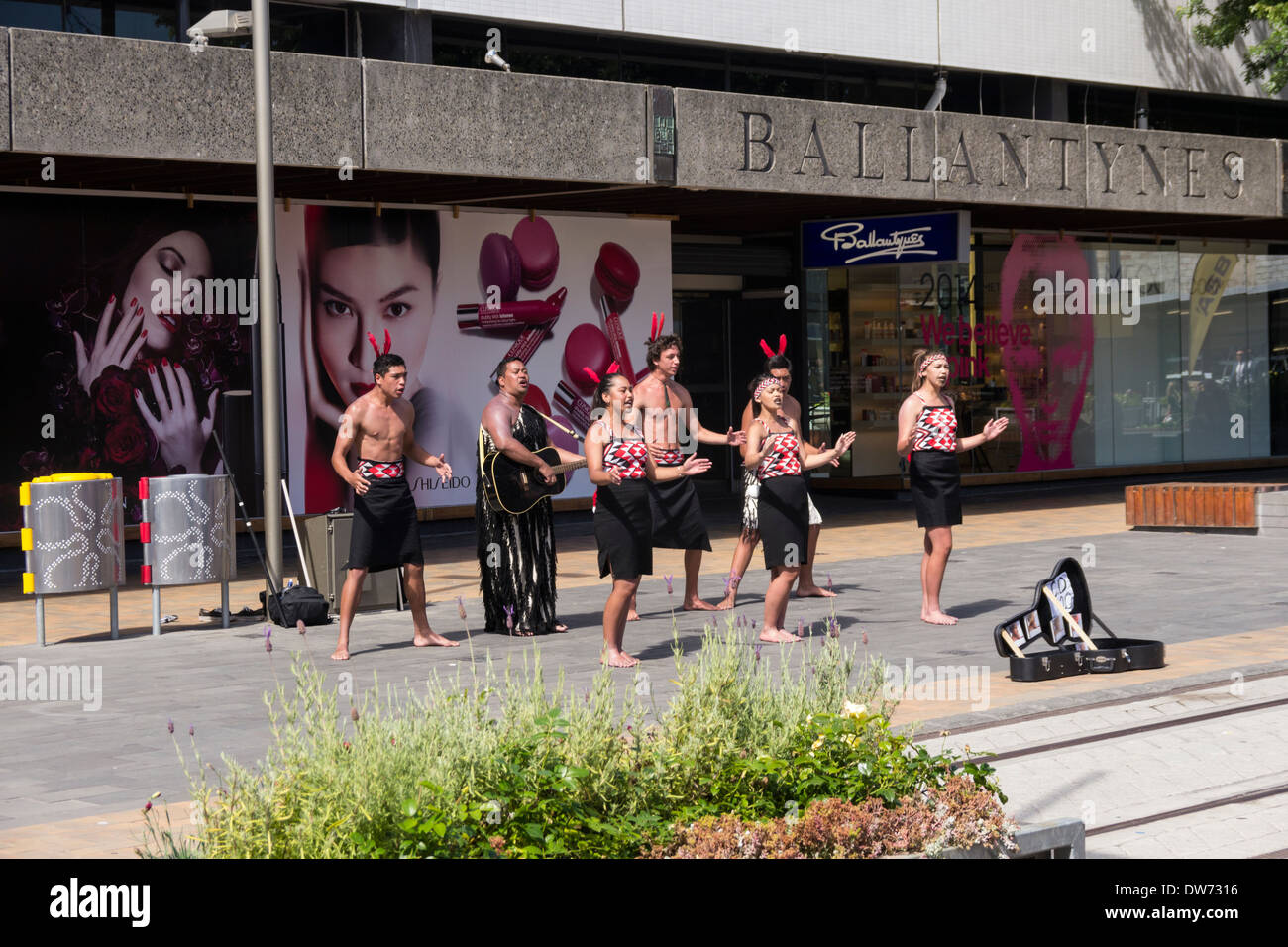Maori entertainers in the Container Mall, Christchurch, New Zealand, with Ballantynes department store in the background. - Stock Image