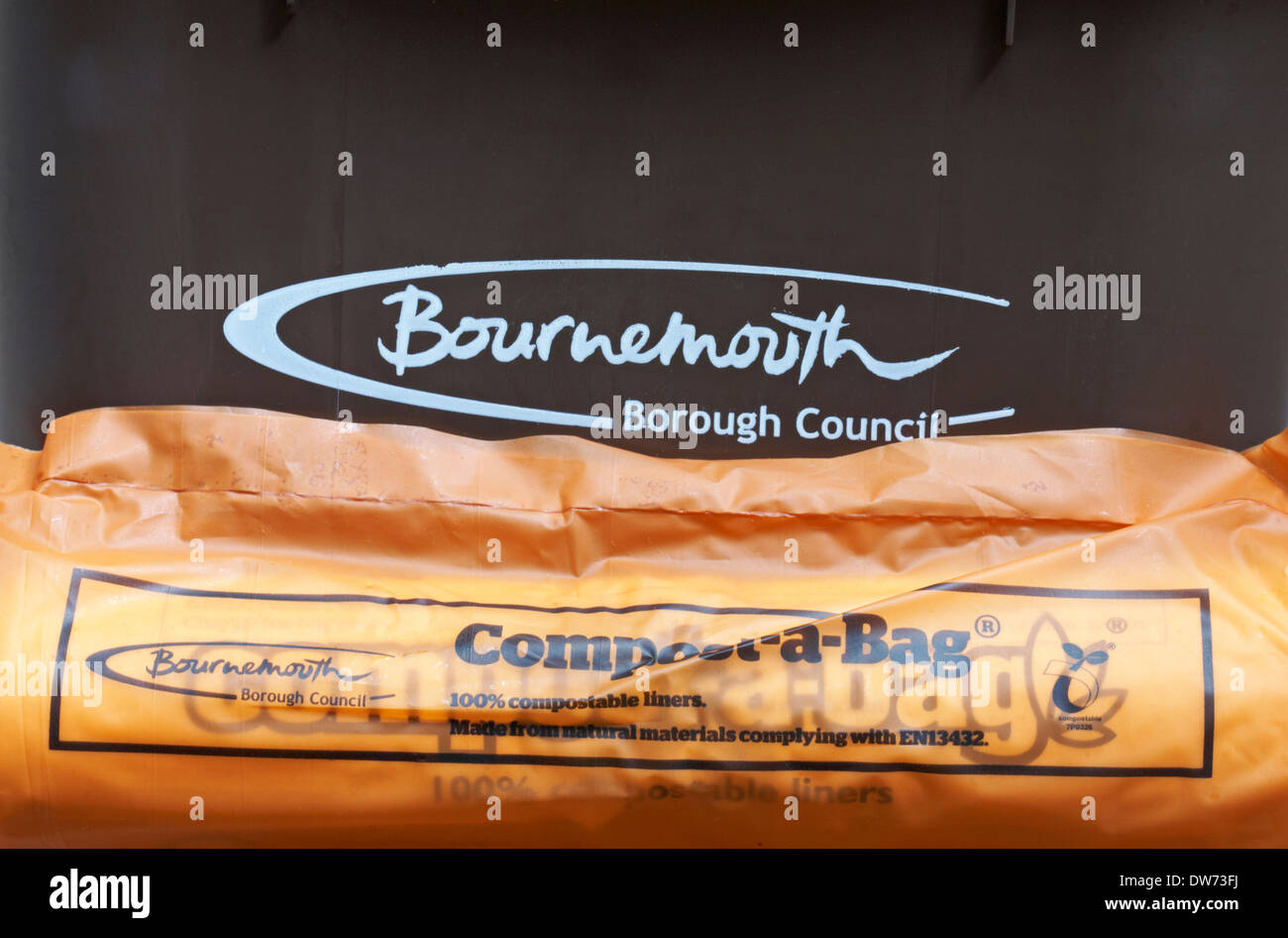 Bournemouth Borough Council food waste bin with compost-a-bag 100% compostable liners made from natural materials - Stock Image