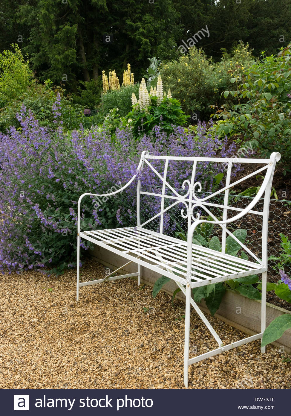 Pleasing Ornate White Metal Bench Seat In Front Of Flower Bed Border Theyellowbook Wood Chair Design Ideas Theyellowbookinfo
