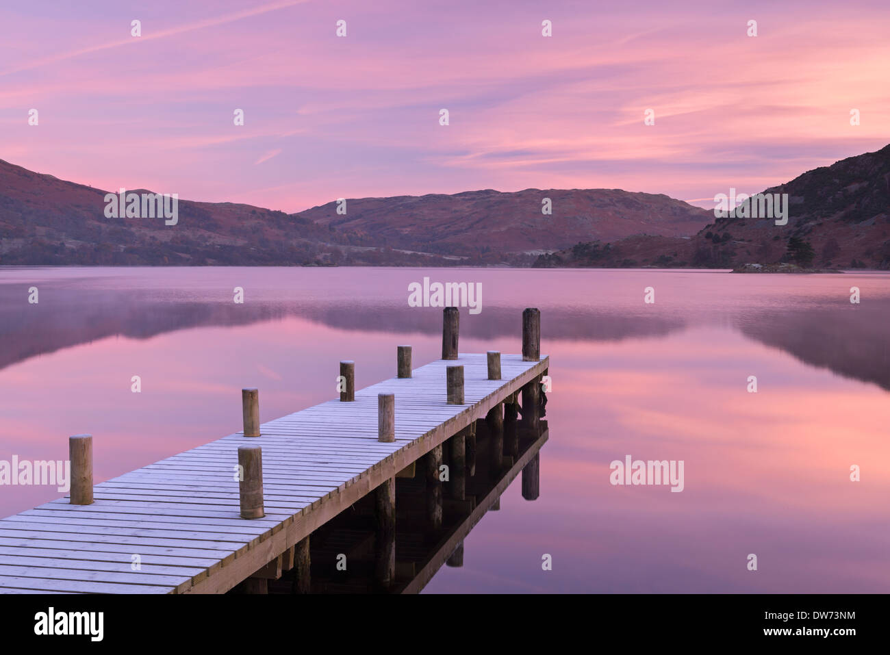 Frosty wooden jetty on Ullswater at dawn, Lake District, Cumbria, England. Winter (November) 2013. - Stock Image