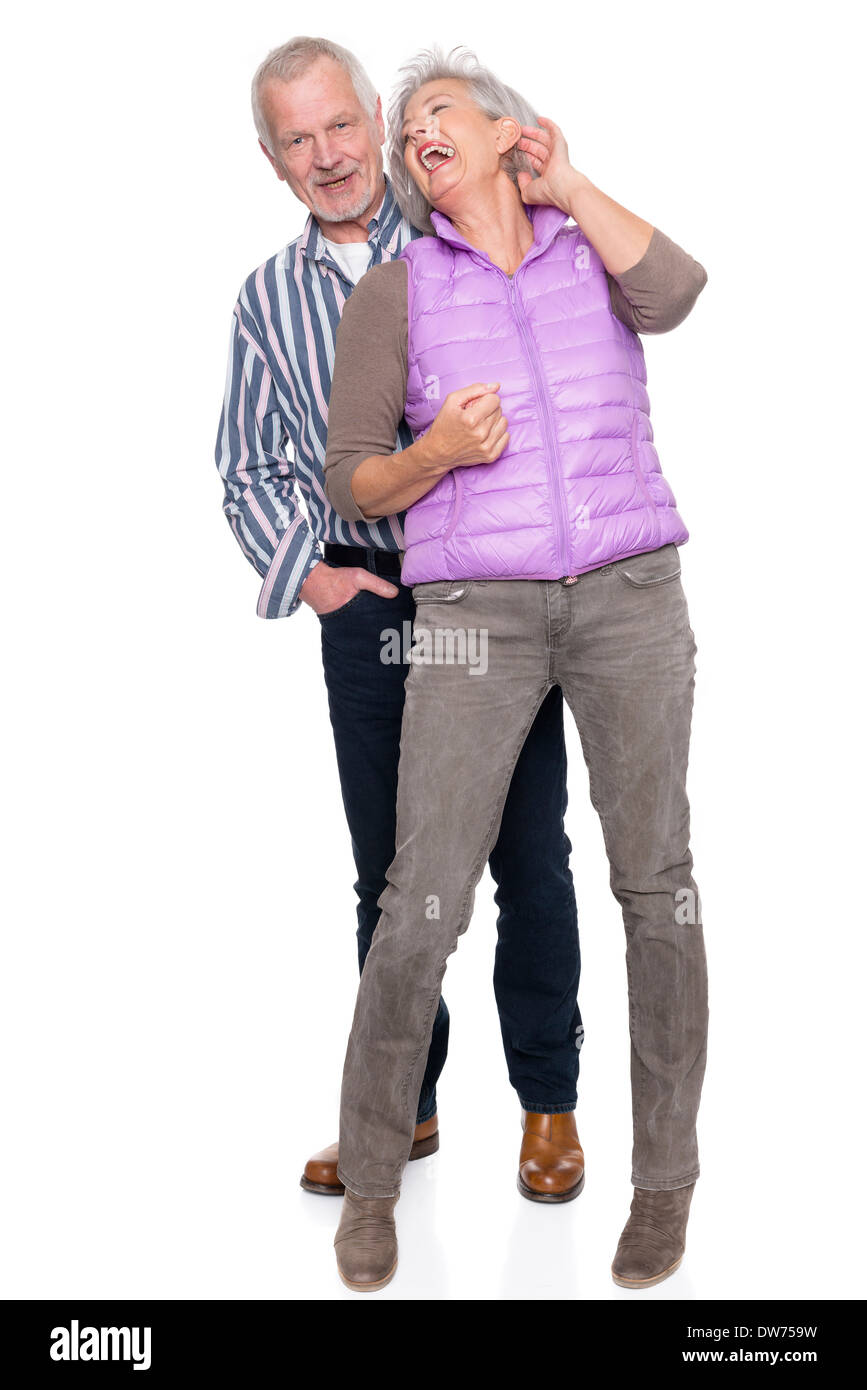 Smiling senior couple in front of white background - Stock Image