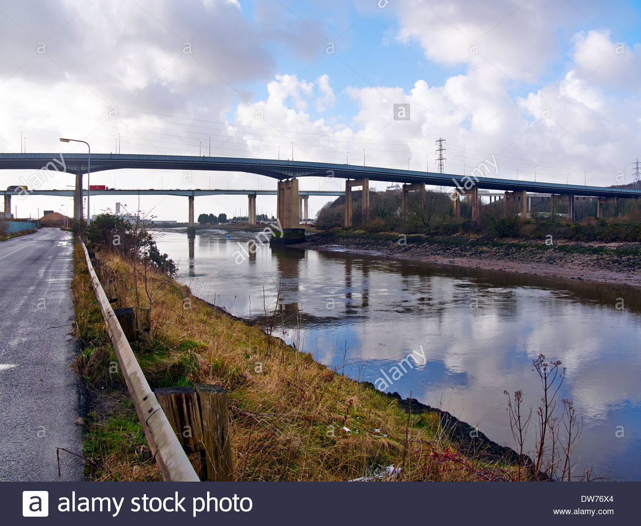 young's boat yard on the river neath under m4 and a48 road bridges crymlyn burrows briton ferry neath south wales - Stock Image