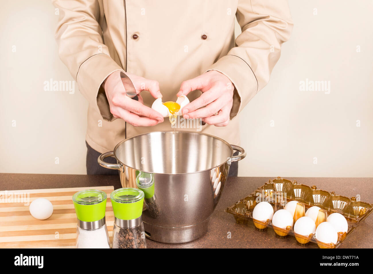 cook egg retrieves from the shell of for cooking - Stock Image