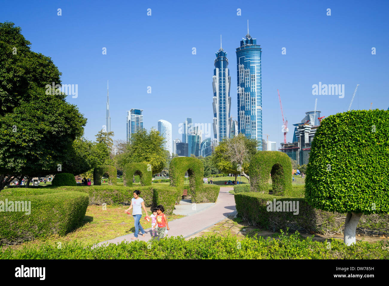 Maze garden and skyline of city from Al Safa Park in Dubai United Arab Emirates - Stock Image