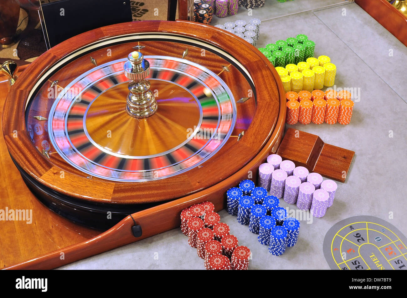 image with a casino spinning roulette wheel with the ball - Stock Image