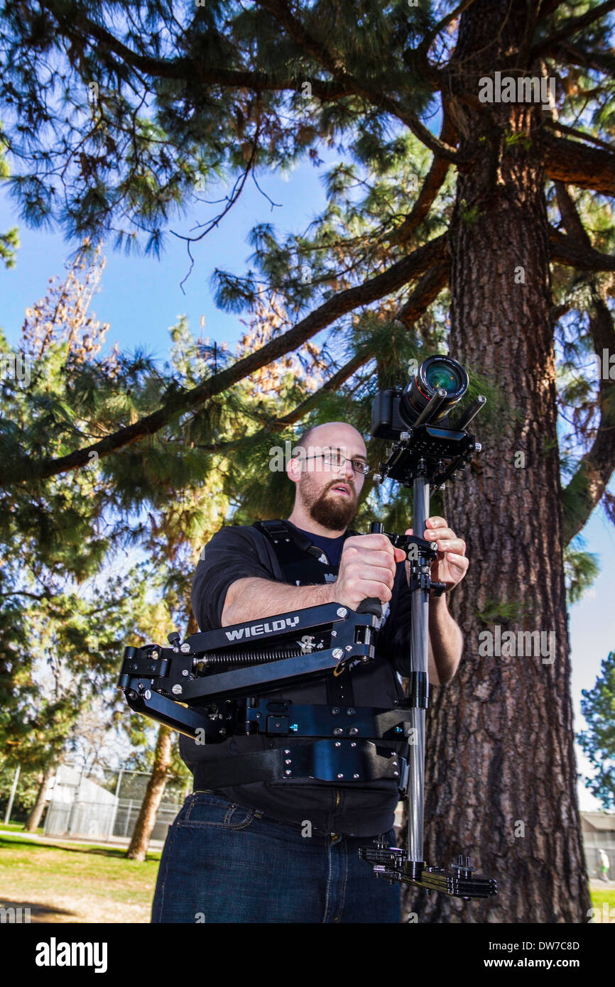 A young man with a DSLR steadycam rig Stock Photo