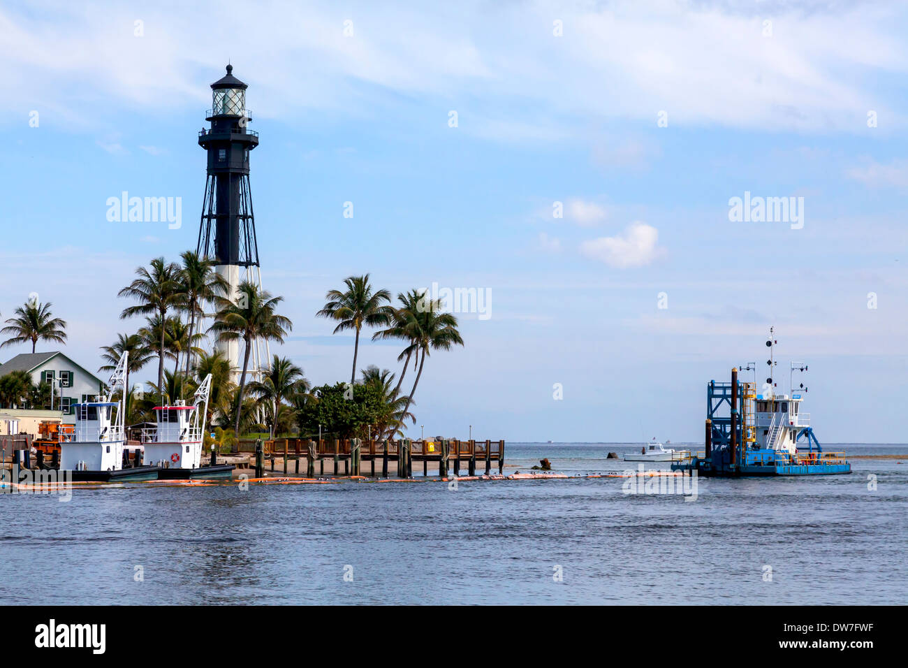 Completed in 1907, the historic 167 foot tall Hillsboro Inlet Lighthouse sits on the point of land on the northeastStock Photo