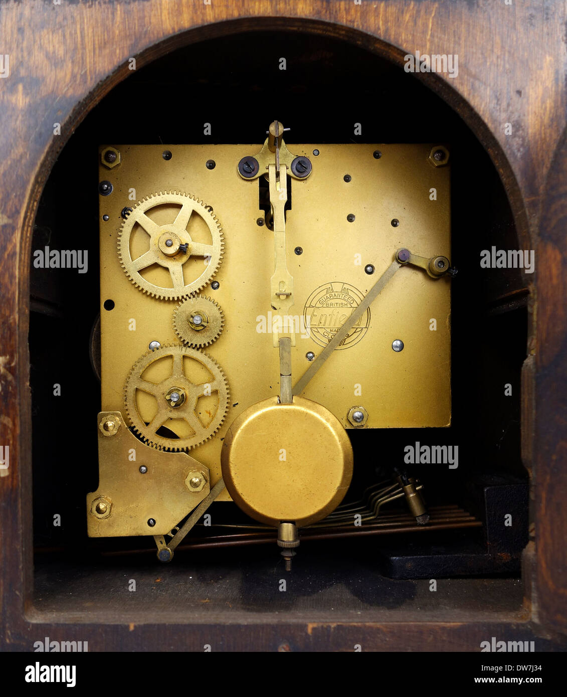 the inner workings of an old lever wind clock - Stock Image