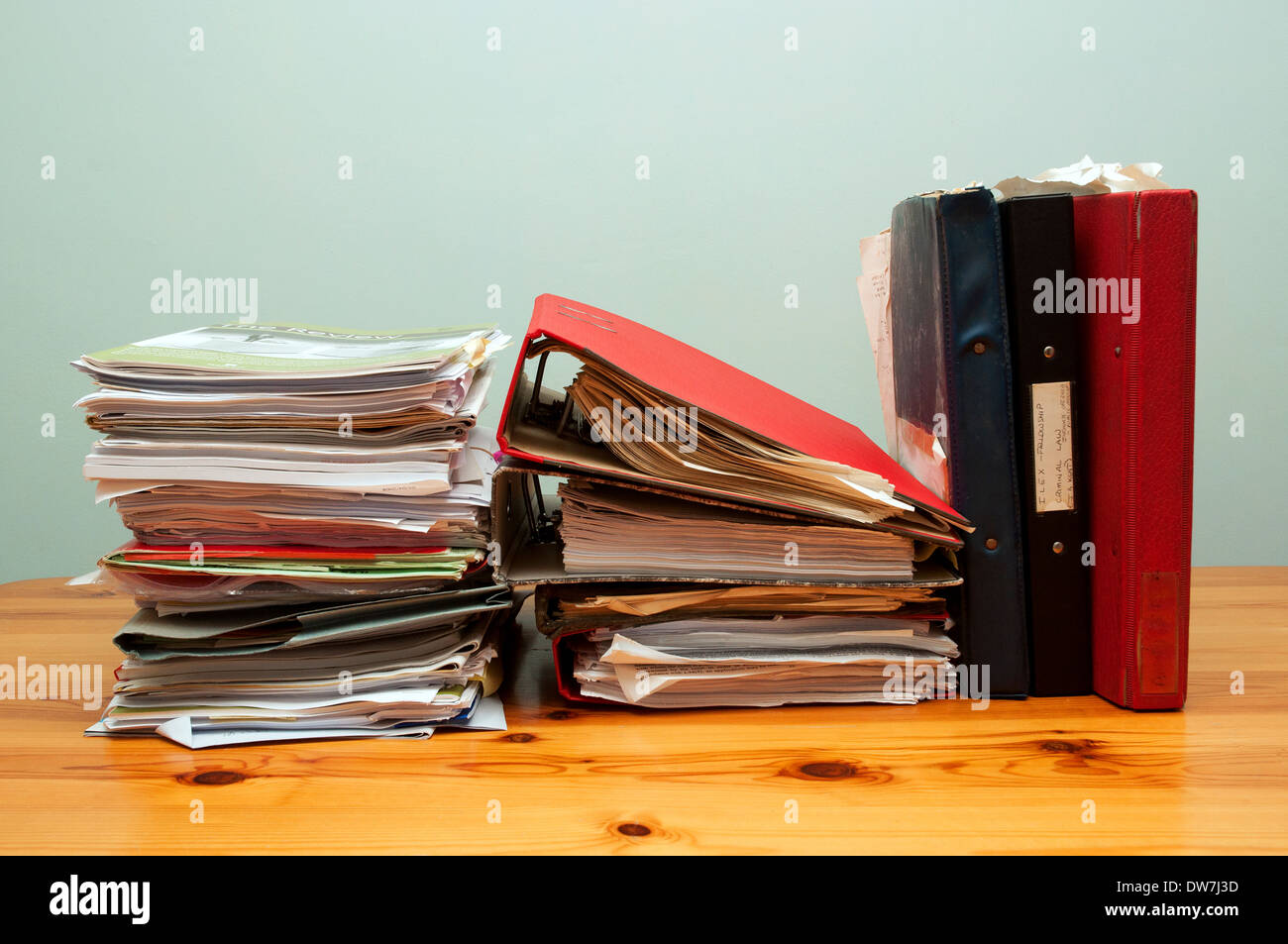 a pile of office files and paperwork on a desk - Stock Image