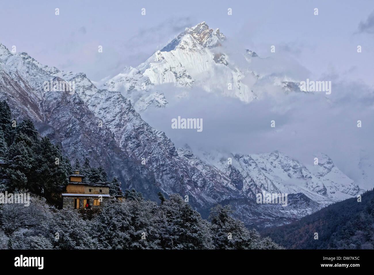 Gumba Lungdang Monastery and peaks of the Ganesh Himal range, Nepal. - Stock Image