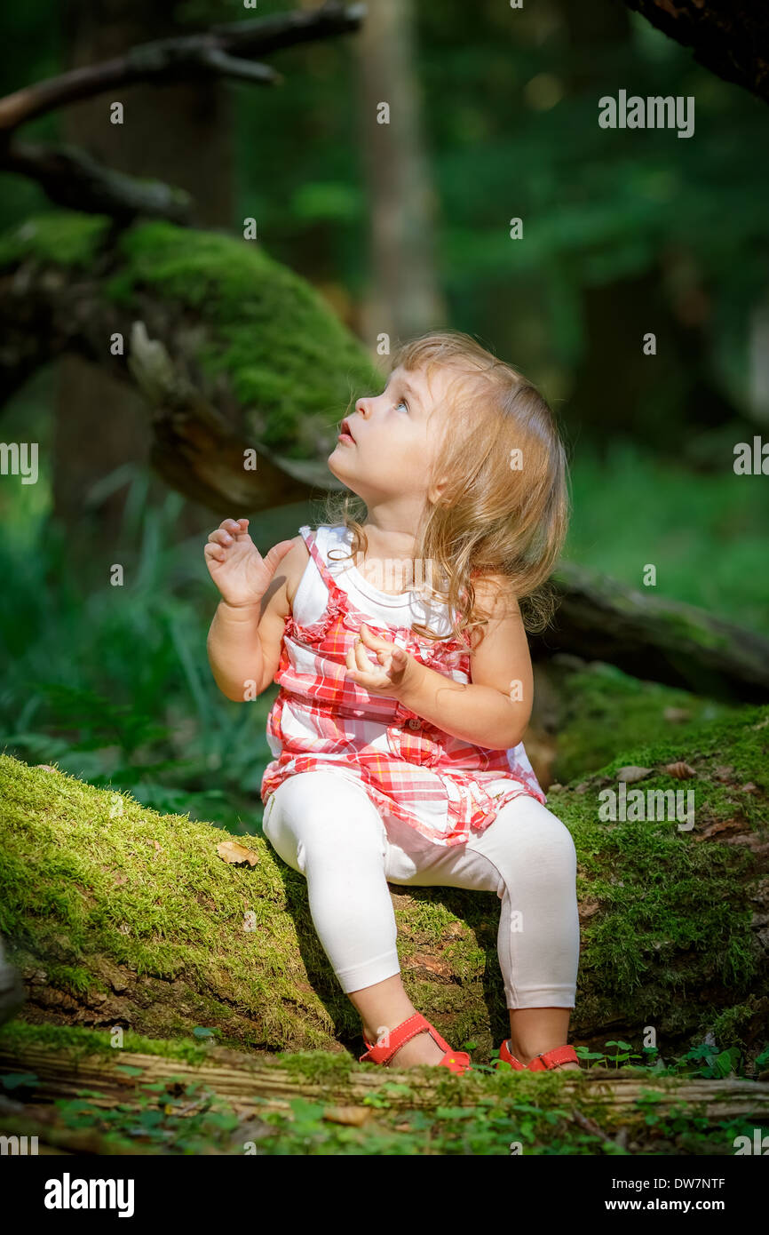 Little girl in the forest - Stock Image
