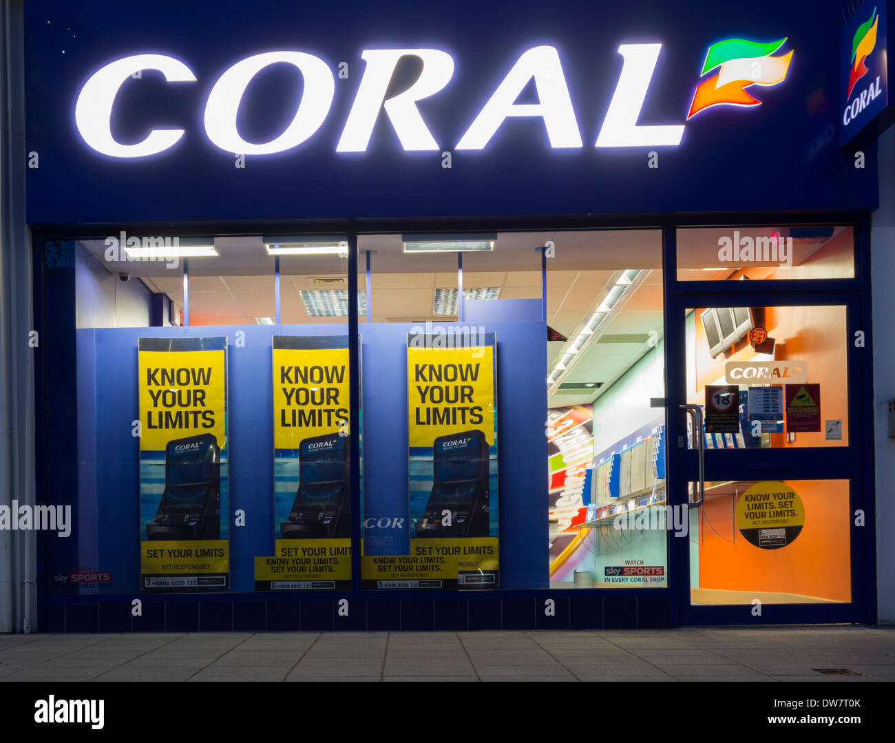 Gamble responsibly posters showing national gambling helpline number in Coral Bookmakers. Stock Photo