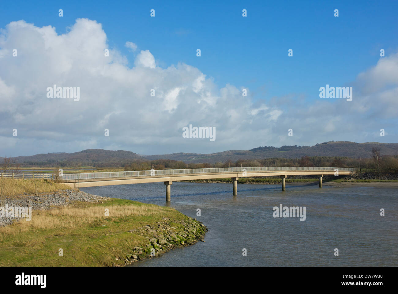 Footbridge over tidal estuary - River Leven - at Greenodd, South Lakeland, Cumbria, England UK Stock Photo