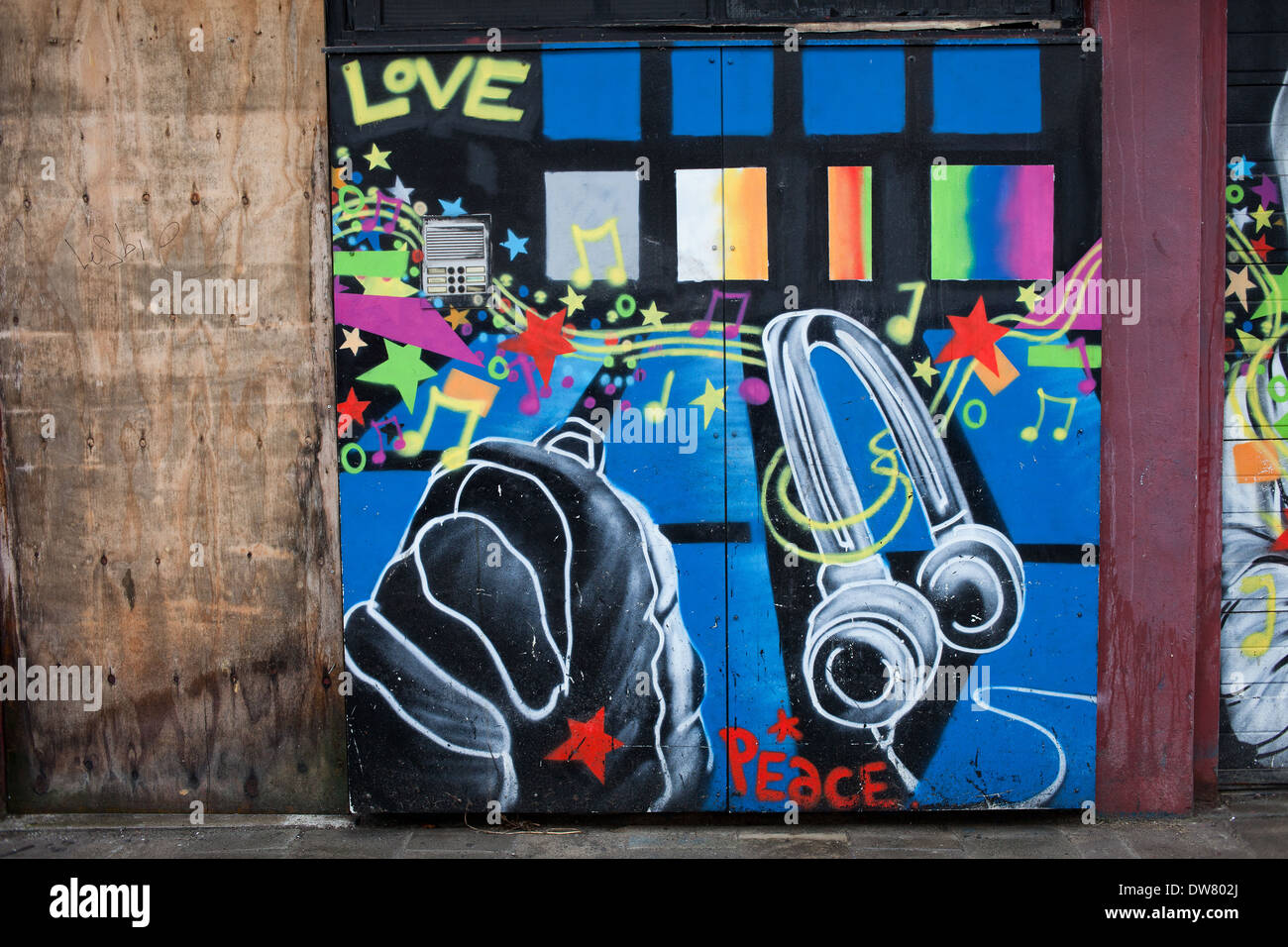 Graffiti on a garage doors with love peace and music theme street art in Rotterdm Holland Netherlands. & Graffiti on a garage doors with love peace and music theme street ...