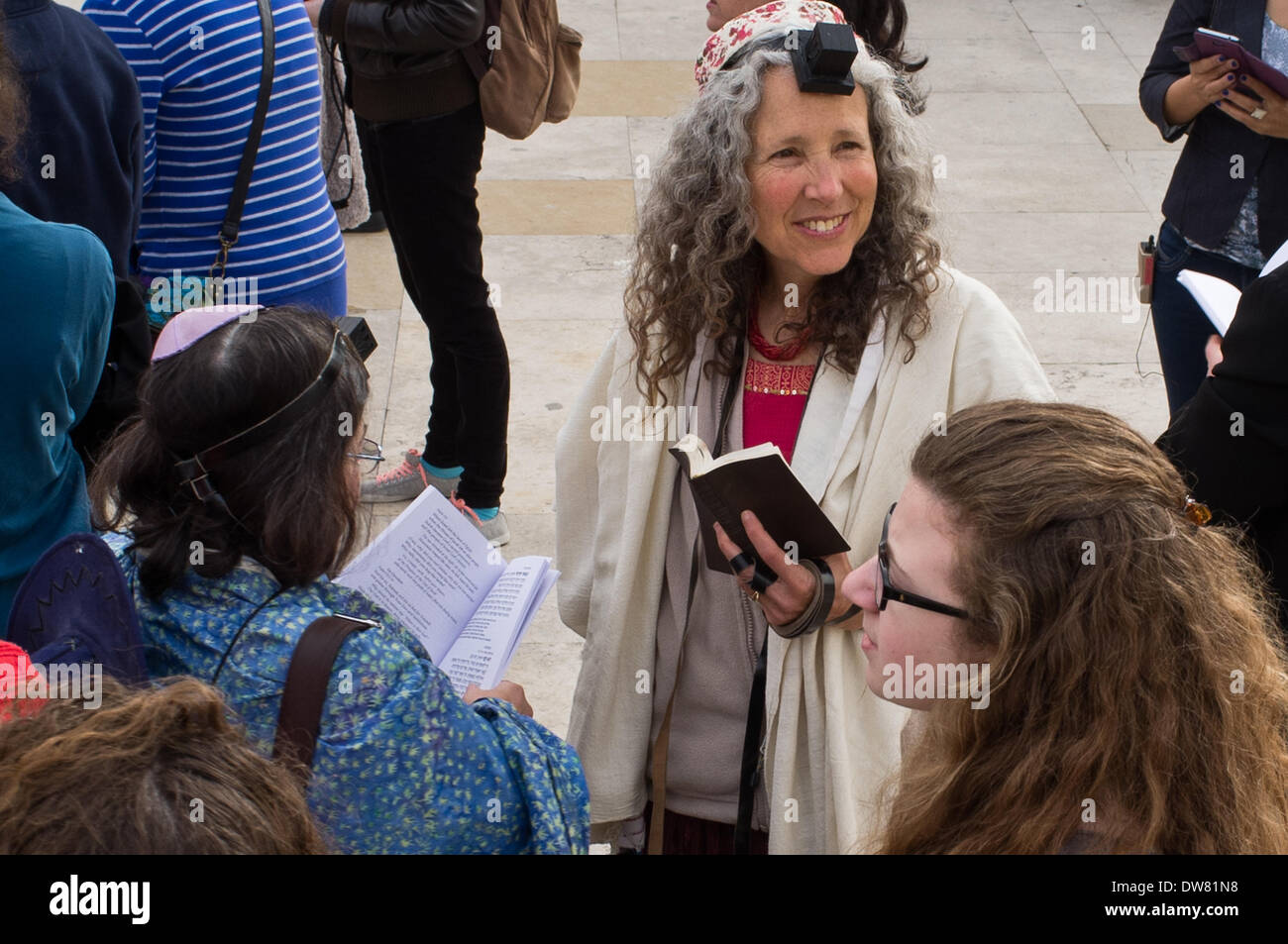 Jerusalem, Israel. 3rd March, 2014. Reform Jewish women, mostly belonging to the 'Women of the Wall' movement, pray in the women's section wearing Phylacteries in a manner reserved by Orthodox Judaism only to men as they celebrate the beginning of the Hebrew month of Adar II at the Kotel, the Western Wall. Credit:  Nir Alon/Alamy Live News - Stock Image