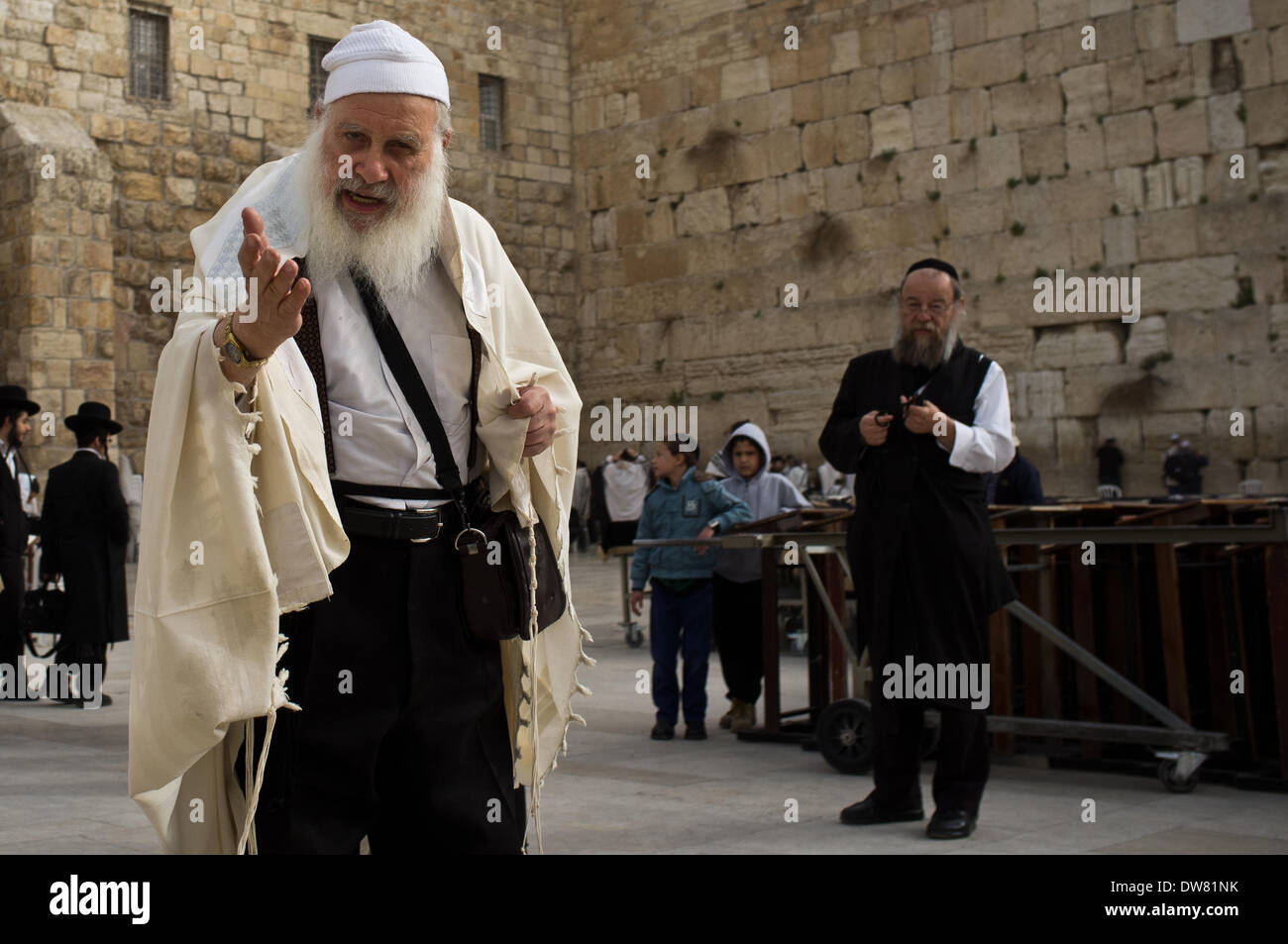 Jerusalem, Israel. 3rd March, 2014. A religious Jewish man loudly protests the manner of prayer and singing out loud being conducted by Women of the Wall in the women's section of the Kotel, the Western Wall, on the first of the Jewish month of Adar II. Credit:  Nir Alon/Alamy Live News - Stock Image