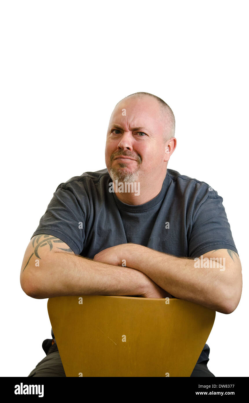 Bald headed man with dubious or doubting expression - Stock Image