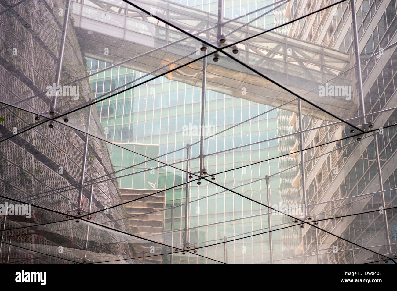 Glass and steel construction in the Singapore financial district. - Stock Image