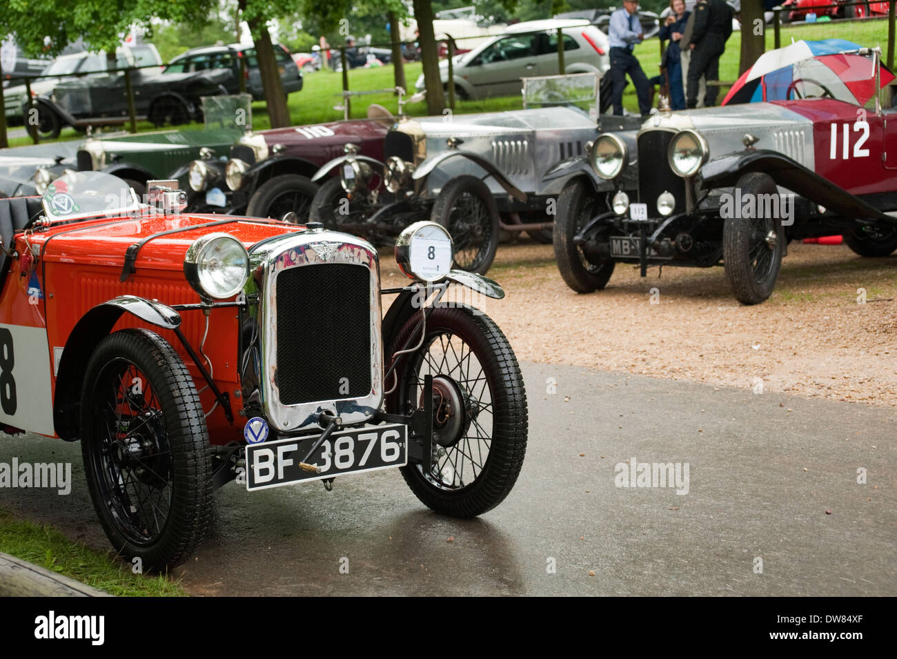 A vintage 1930s Austin 7-The Toy, parked in front of 1920s Vauxhalls at the VSCC  Hill Climb, Gloucestershire, England, UK. - Stock Image