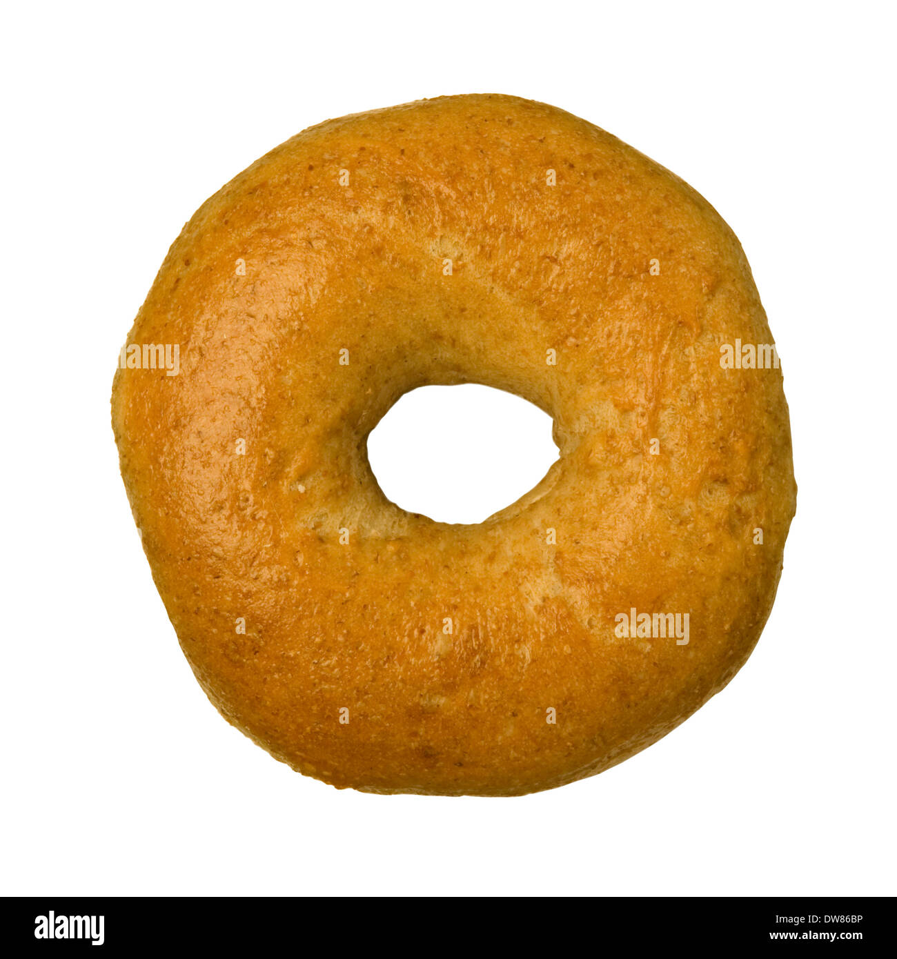 Whole wheat bagel isolated against white background - Stock Image