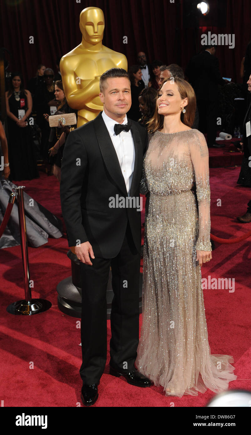 Los Angeles, USA. 2nd Mar, 2014. Brad Pitt (L) and Angelina Jolie arrive at the red carpet for the 2014 Oscars at Stock Photo