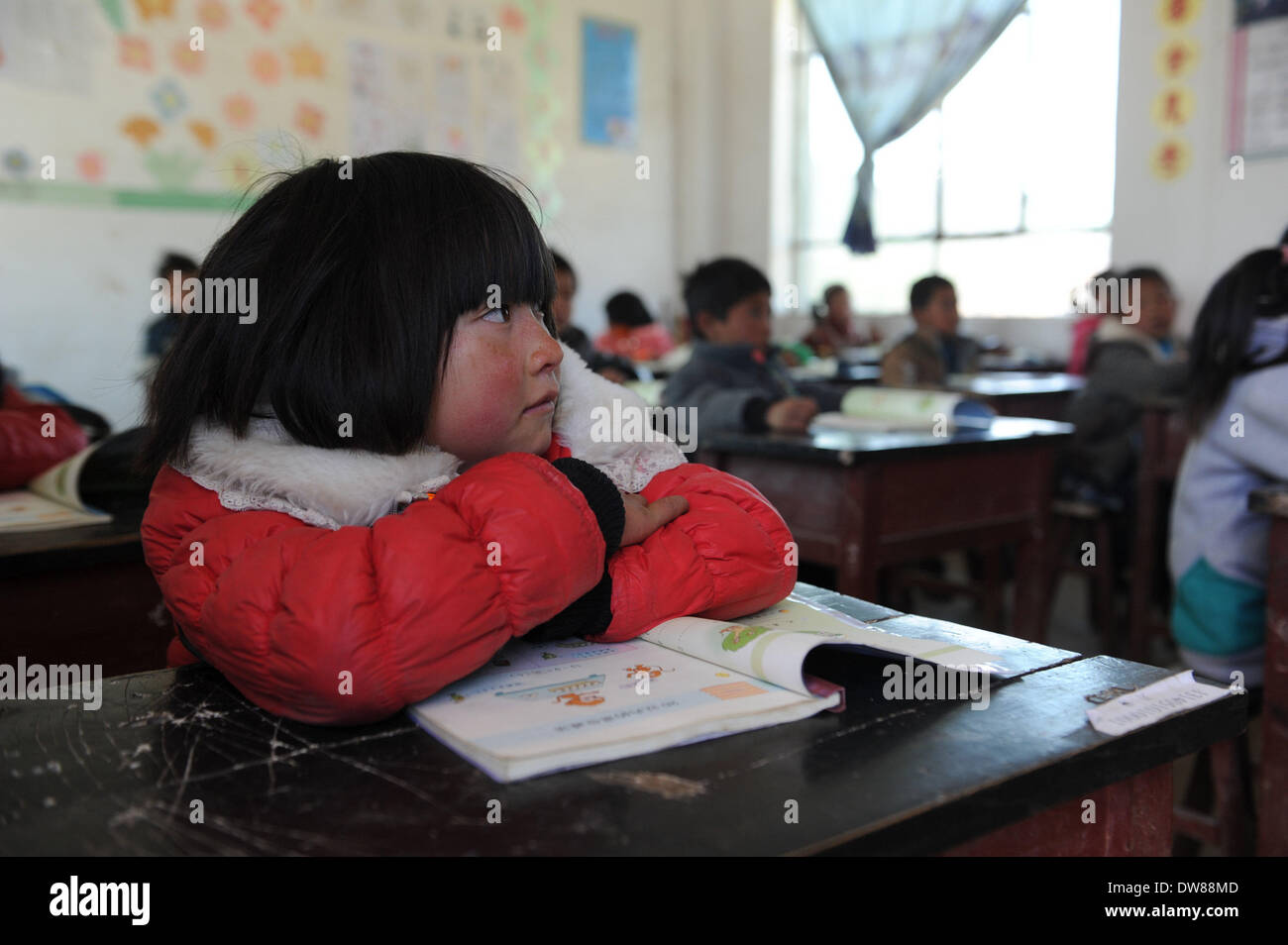(140303) -- WEINING, March 3, 2014 (Xinhua) -- Students are in class at Qianfeng Primary School in Weining County, southwest China's Guizhou Province, Mach 3, 2014. Monday marks the beginning of a new term for students at Qianfeng Primary School. The school, with an altitude of 2,500 meters, sits in mountainous areas in Guizhou and only has 48 pupils. (Xinhua/Tao Liang) (zc) - Stock Image