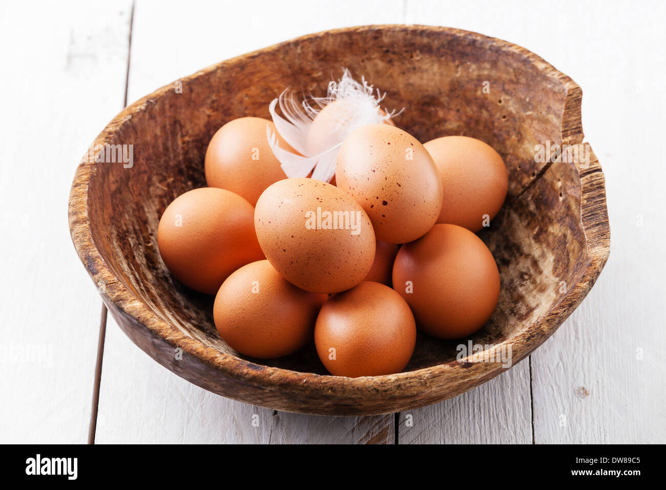Eggs in bowl on wooden background Stock Photo