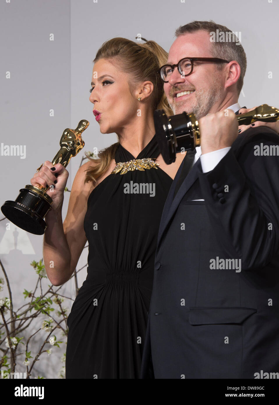 Los Angeles, USA. 2nd Mar, 2014. Morgan Neville (R) and Caitrin Rogers pose after winning the Best Documentary Feature for '20 Feet from Stardom' at the Dolby Theatre in Hollywood, California, the United States, March 2, 2014. Credit:  Yang Lei/Xinhua/Alamy Live News - Stock Image