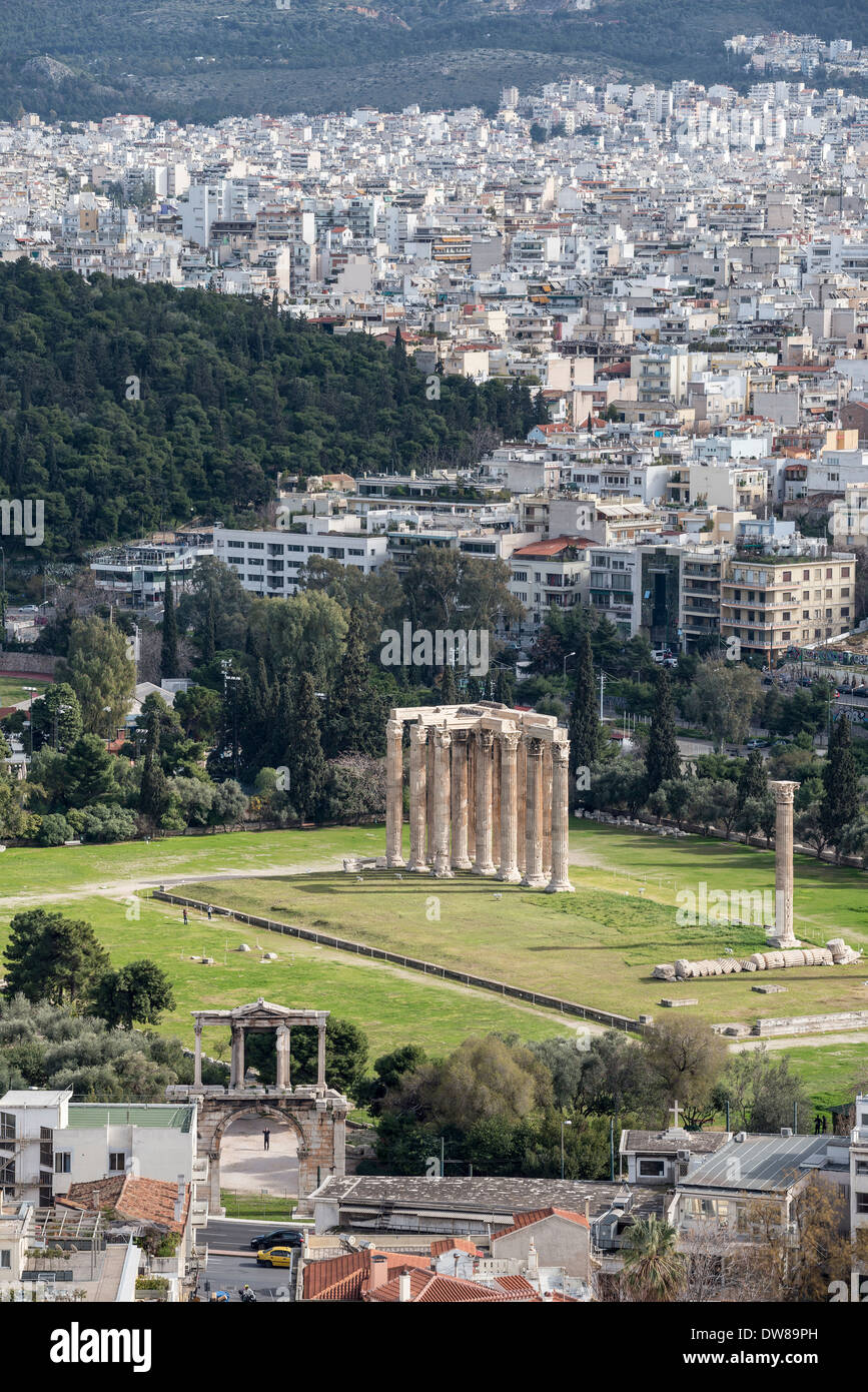 Ancient sites of Hadrians arch and the Temple of Olympian Zeus seen against the modern city skyline of Athens, Greece, - Stock Image
