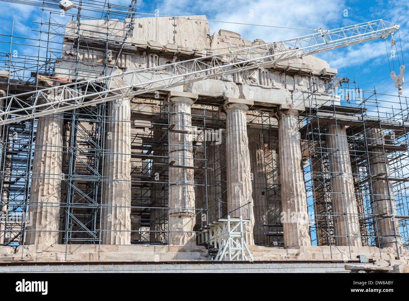 Scaffolding and crains obscure the facade of the Parthenon whilst undergoing major restoration, Athens, Greece. - Stock Image